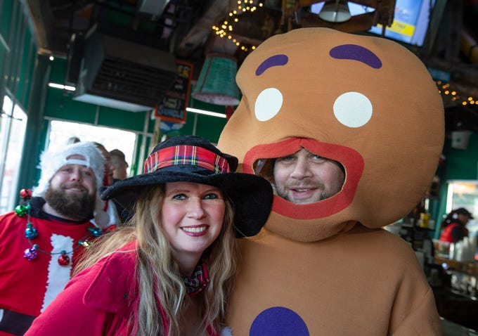 Michelle Farrell to Toms River and Ed Poplaski of Wall at Johnny Mac during SantaCon Bar Crawl through Asbury Park on December 8, 2018.