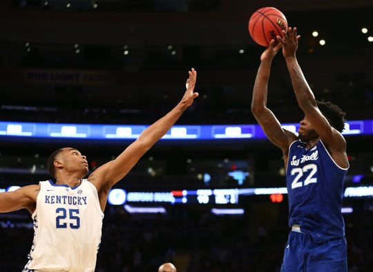 Seton Hall Pirates guard Myles Cale (22) puts up a shot against Kentucky Wildcats forward PJ Washington (25) during overtime