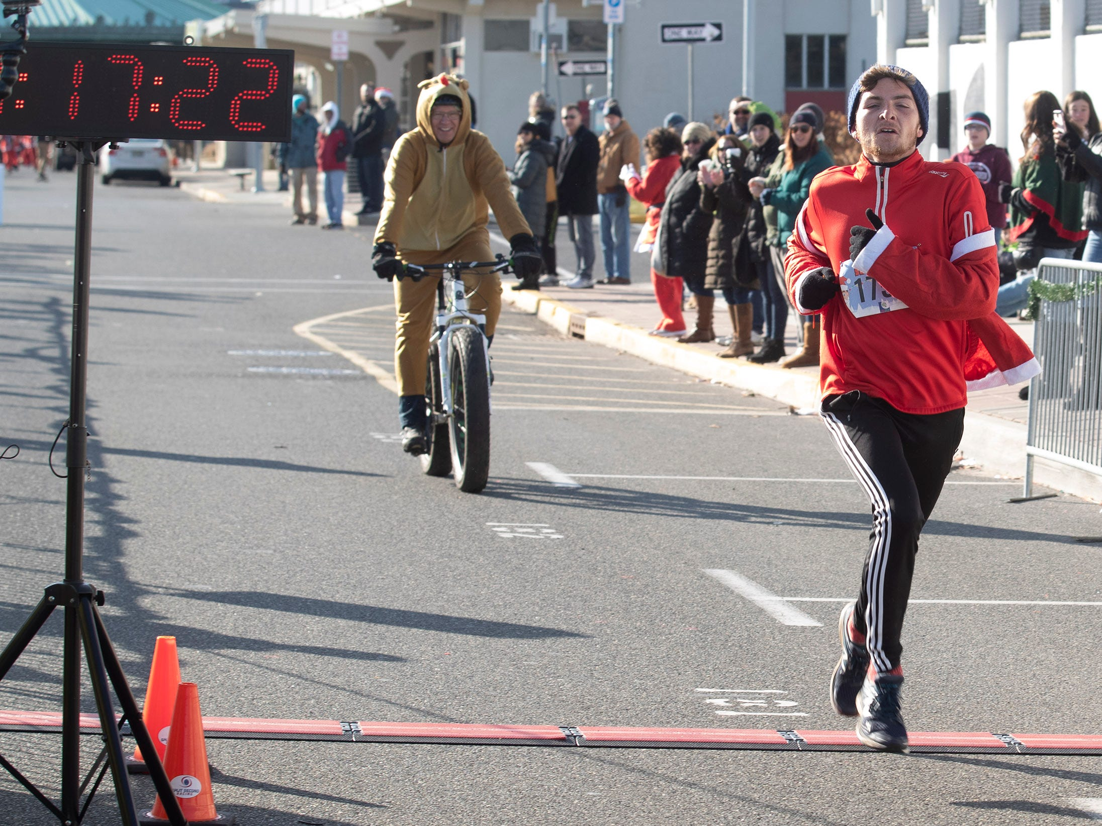 Kevin Knoetig takes first place in Santa Run. Runners brave the cold to participate in the annual Santa Run 5K in Asbury Park on December 8, 2018.