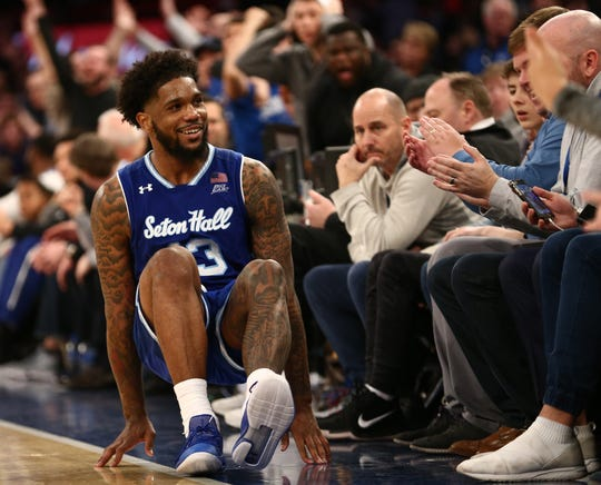 Seton Hall Pirates guard Myles Powell (13) reacts with fans during overtime against the Kentucky Wildcats
