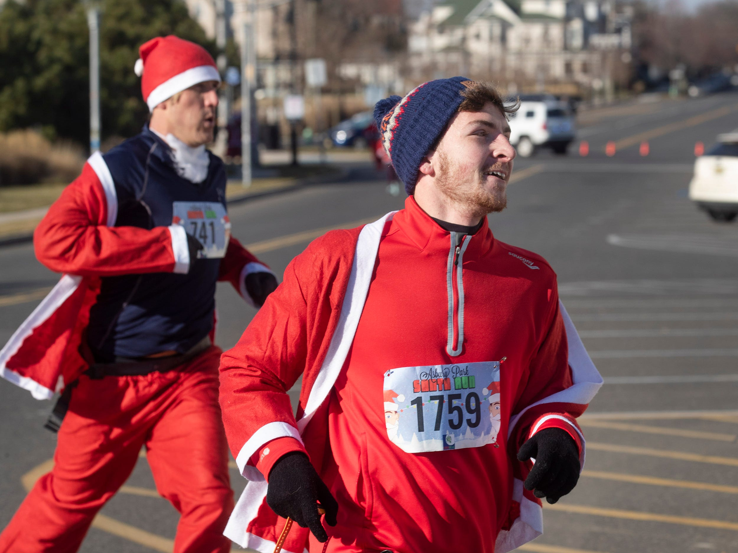 Kevin Knoetig has the lead after first lap and kept it to be the eventual winnerRunners brave the cold to participate in the annual Santa Run 5K in Asbury Park on December 8, 2018.