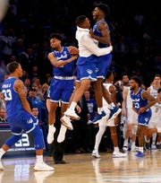 Seton Hall players celebrate after defeating Kentucky 84-83 in overtime of an NCAA basketball game.