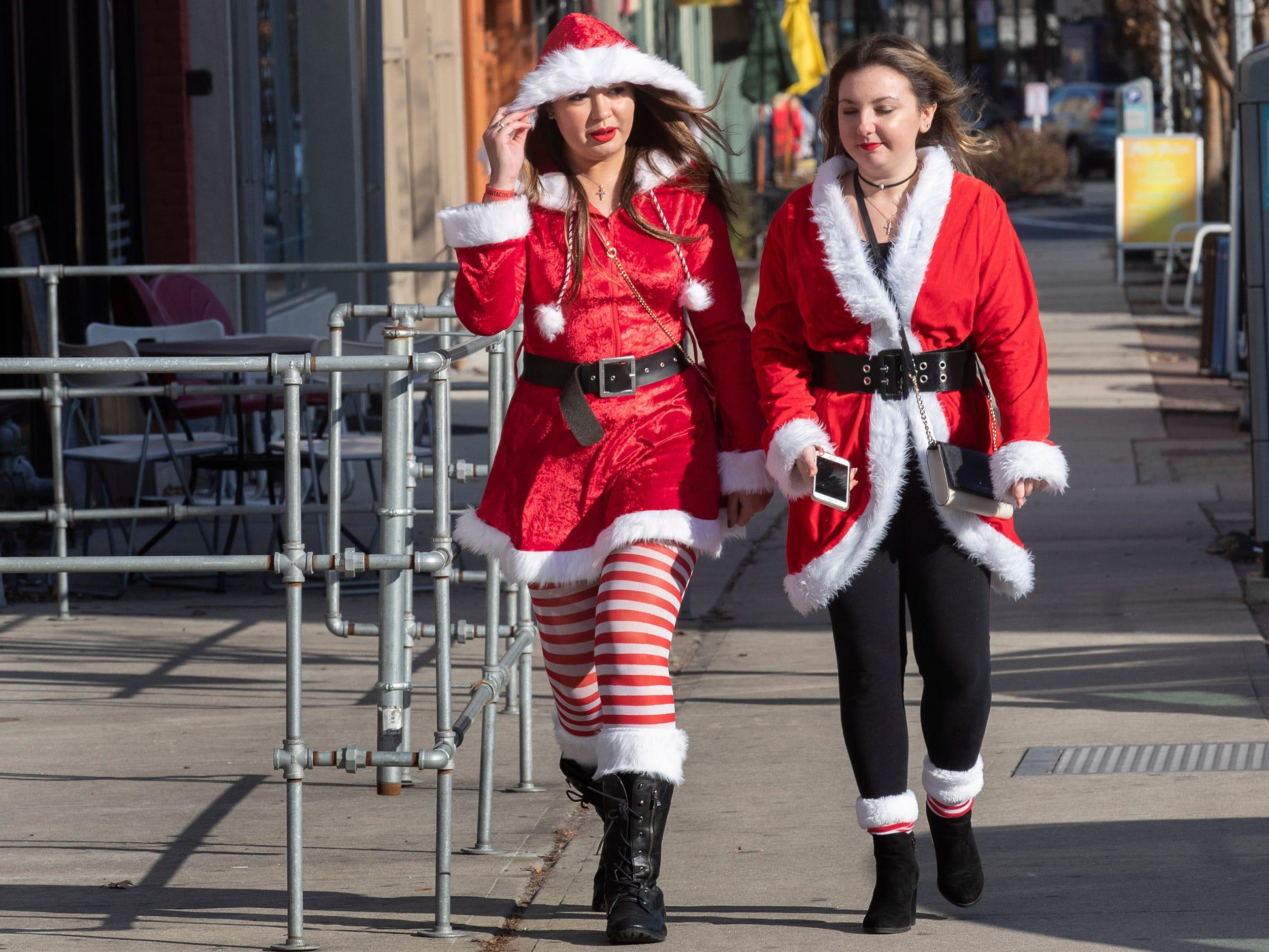 SantaCon participants head to another site as they enjoy the SantaCon Bar Crawl through Asbury Park on December 8, 2018.