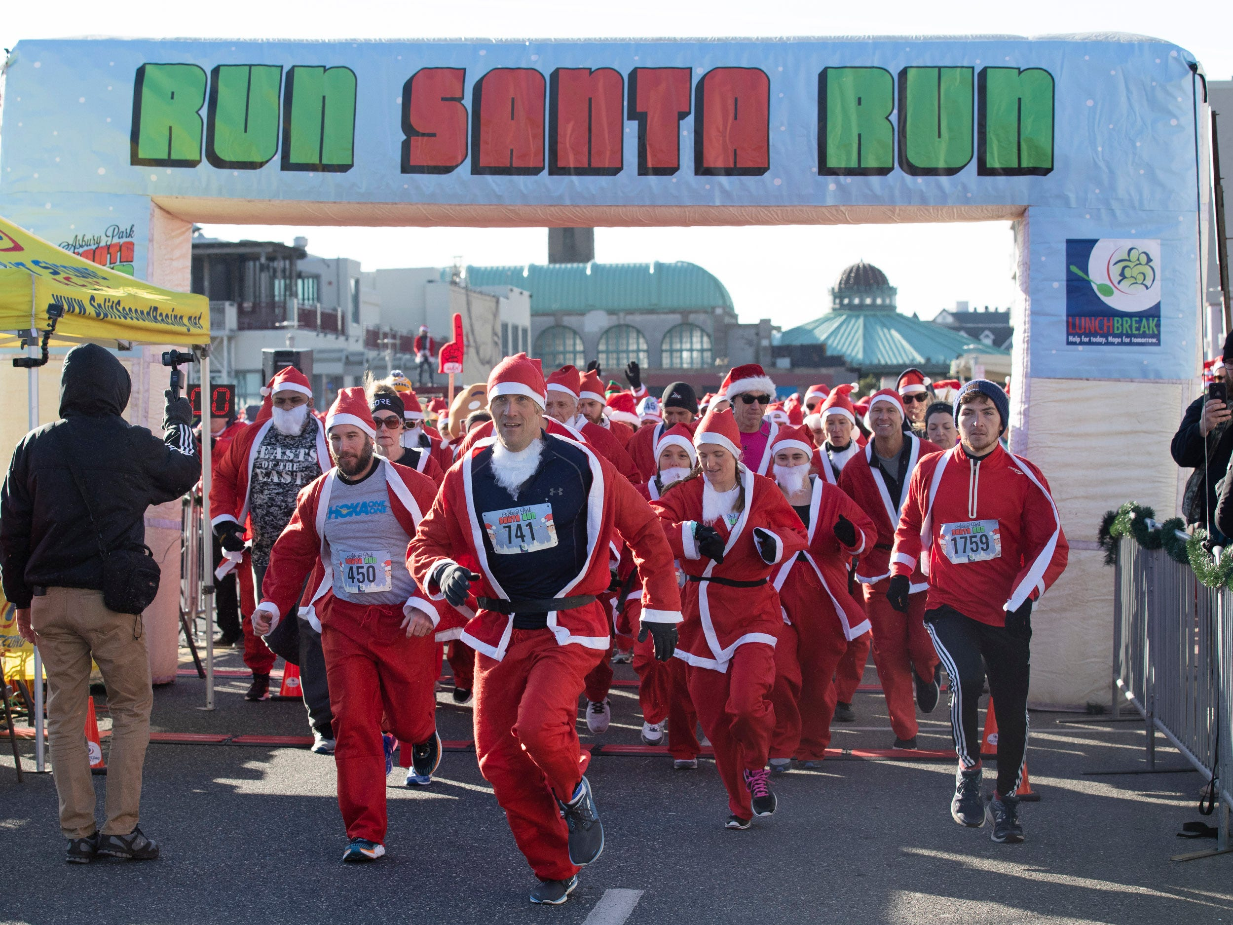 Runners head out on the 2018 Santa Run. Runners brave the cold to participate in the annual Santa Run 5K in Asbury Park on December 8, 2018.