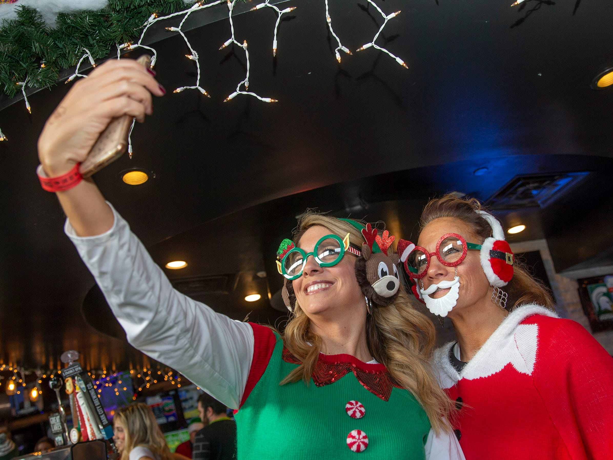 Patrons at Asbury Ale House take a selfie at SantaCon Bar Crawl through Asbury Park on December 8, 2018.