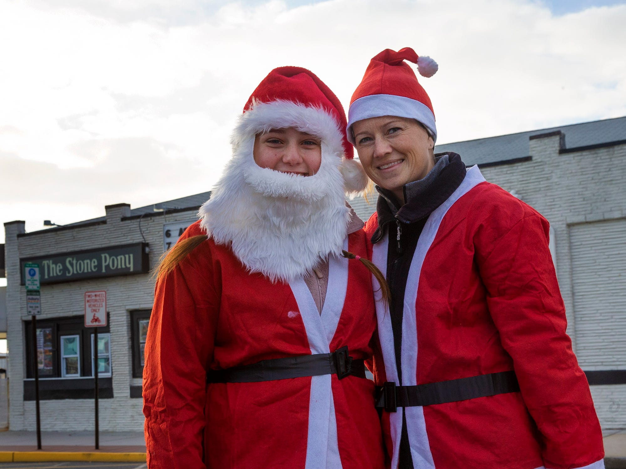 Mikalynn Kirby of Chersteerfield, NJ and Casee Morgan of South Hampton, dress for success in the Santa Run in Asbury Park.
