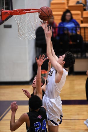Wylie's Austin Brewer (4) goes up for a shot against Midland Christian in the final of the Catclaw Classic at Bulldog Gym on Saturday, Dec. 8, 2018. The Bulldogs return to action Tuesday against Abilene High.