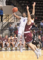 ACU's Jaylen Franklin (0) drives to the basket as Schreiner's Josh Berry defends. ACU won 93-53 on Saturday, Dec. 8, 2018, at Moody Coliseum.