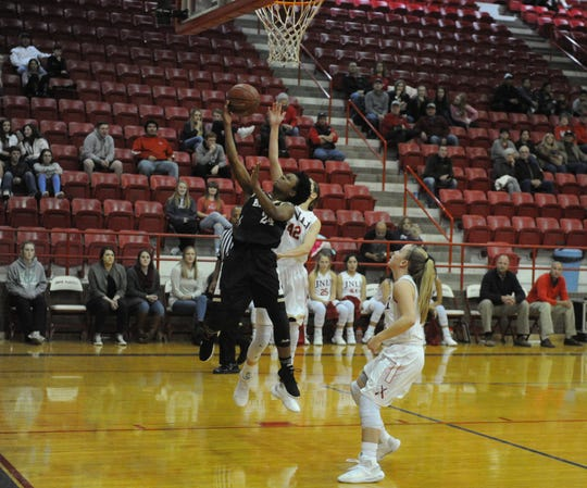 Abilene High guard Trakenya Roberson (24) goes up for a layup in front of Jim Ned's Malone Graham.