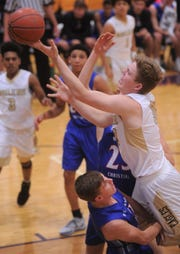Abilene High's Nathan Watts, right, shoots over a Midland Christian defender. The Mustangs beat AHS 52-37 at the Catclaw Classic on Friday, Dec. 7, 2018, at Wylie's Bulldog Gym.