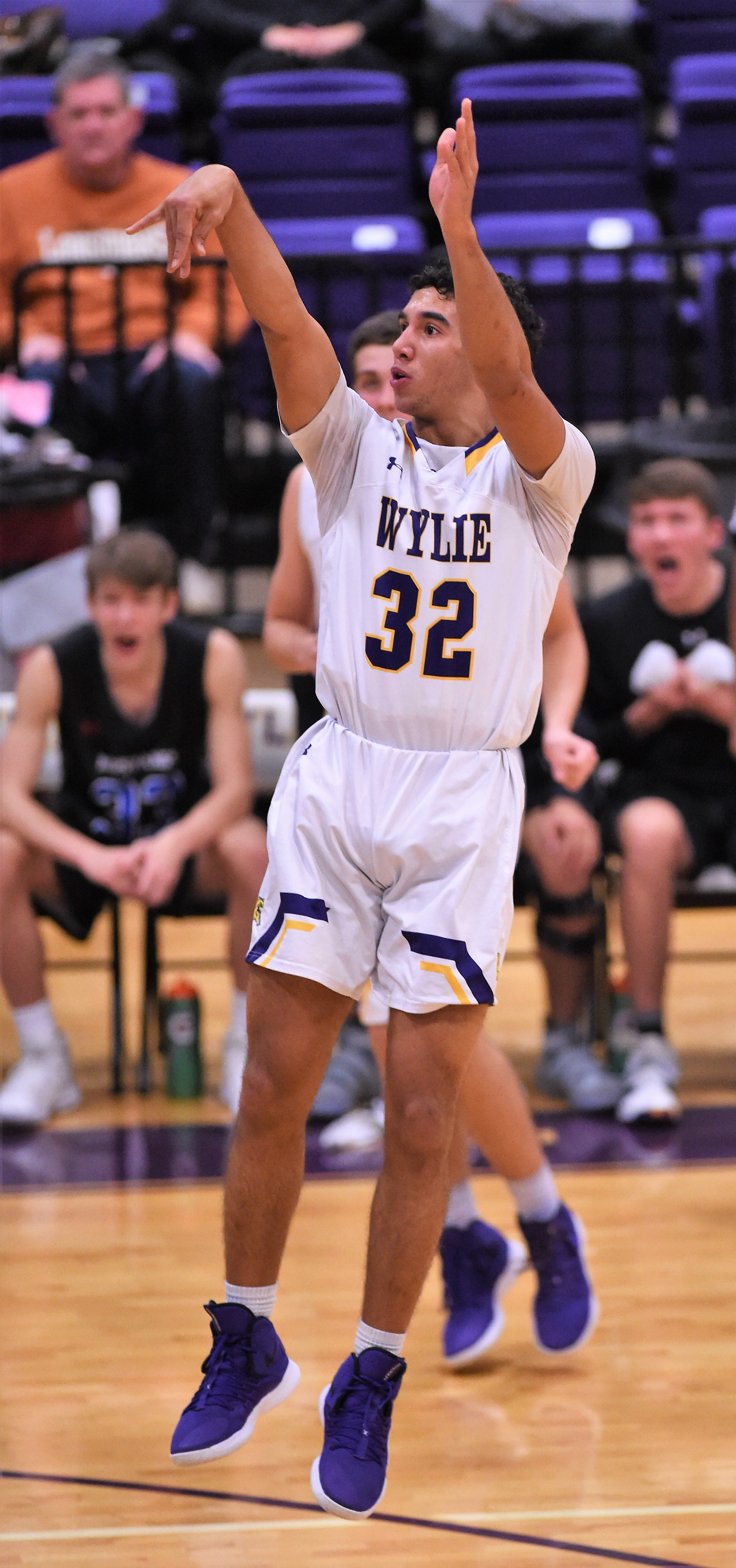 Wylie's Payton Brooks (32) follows through on a shot against Midland Christian in the final of the Catclaw Classic at Bulldog Gym on Saturday, Dec. 8, 2018. The Bulldogs return to action Tuesday against Abilene High.