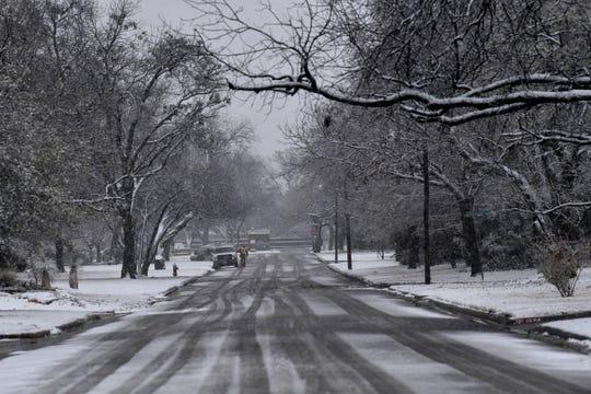 Snow falls in a south Abilene neighborhood Saturday.