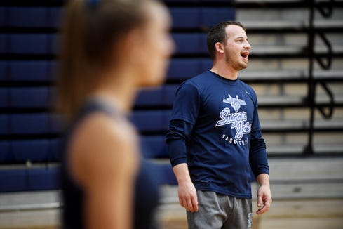 Enka first-year coach Kyle Reagan calls out a drill during practice December 6, 2018.