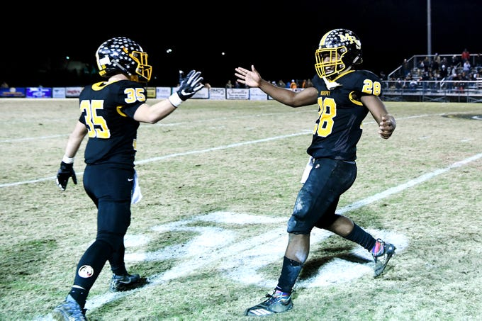 Murphy's Christian Gentry, left, and Devontae Murray, right celebrate after they defeated Robbinsville 28-6 in the NCHSAA 1A West regional final at Murphy High School on Dec. 7, 2018. The Bulldogs will advance to the state championship game.