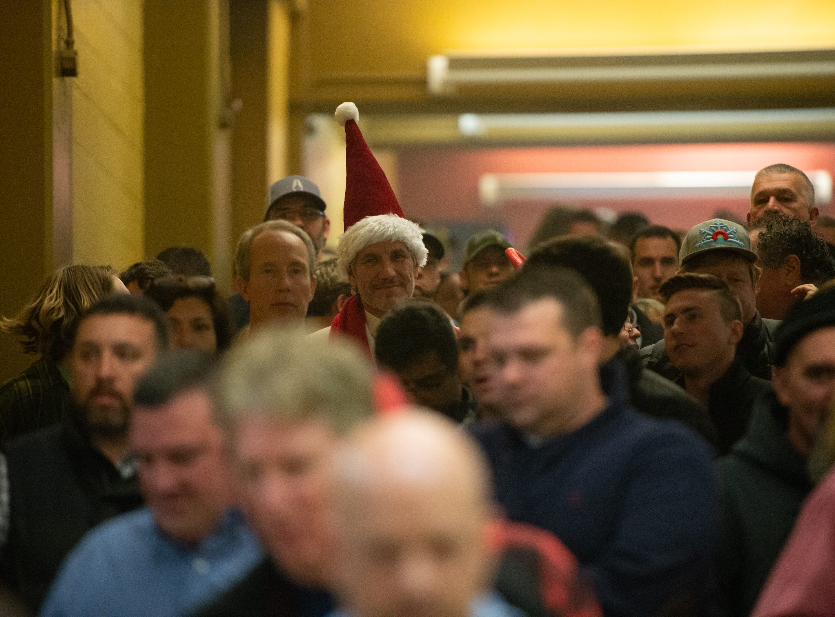 V.I.P attendees of the first night of the 30th annual Christmas Jam at the U.S Cellular Center in Asheville line up to enter Dec. 7, 2018.