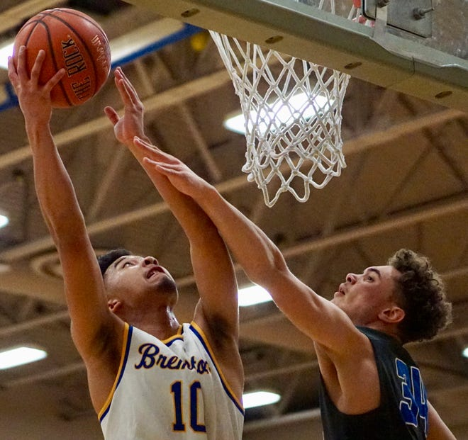 Bremerton's Keoni Laguana puts up a shot during Friday's 51-48 victory against Olympic.
