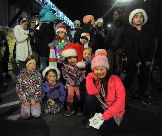 A group of children prepare to watch a performance by dancers from the Black Mountain Center for the Arts during Holly Jolly on Dec. 7.