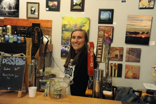 Minutes before Holly Jolly gets underway, Kelly Ann Madden gets ready for a busy night at BAD Craft on Cherry Street.