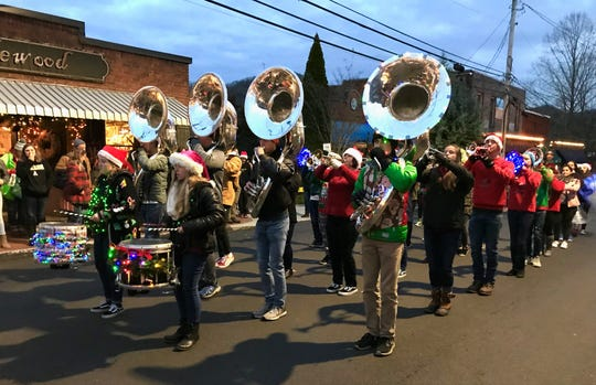 The Owen High School Marching Band performs on Cherry Street during Holly Jolly in 2018.