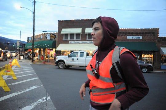 Owen High School junior David Shepard directs traffic during Holly Jolly on Dec. 7.
