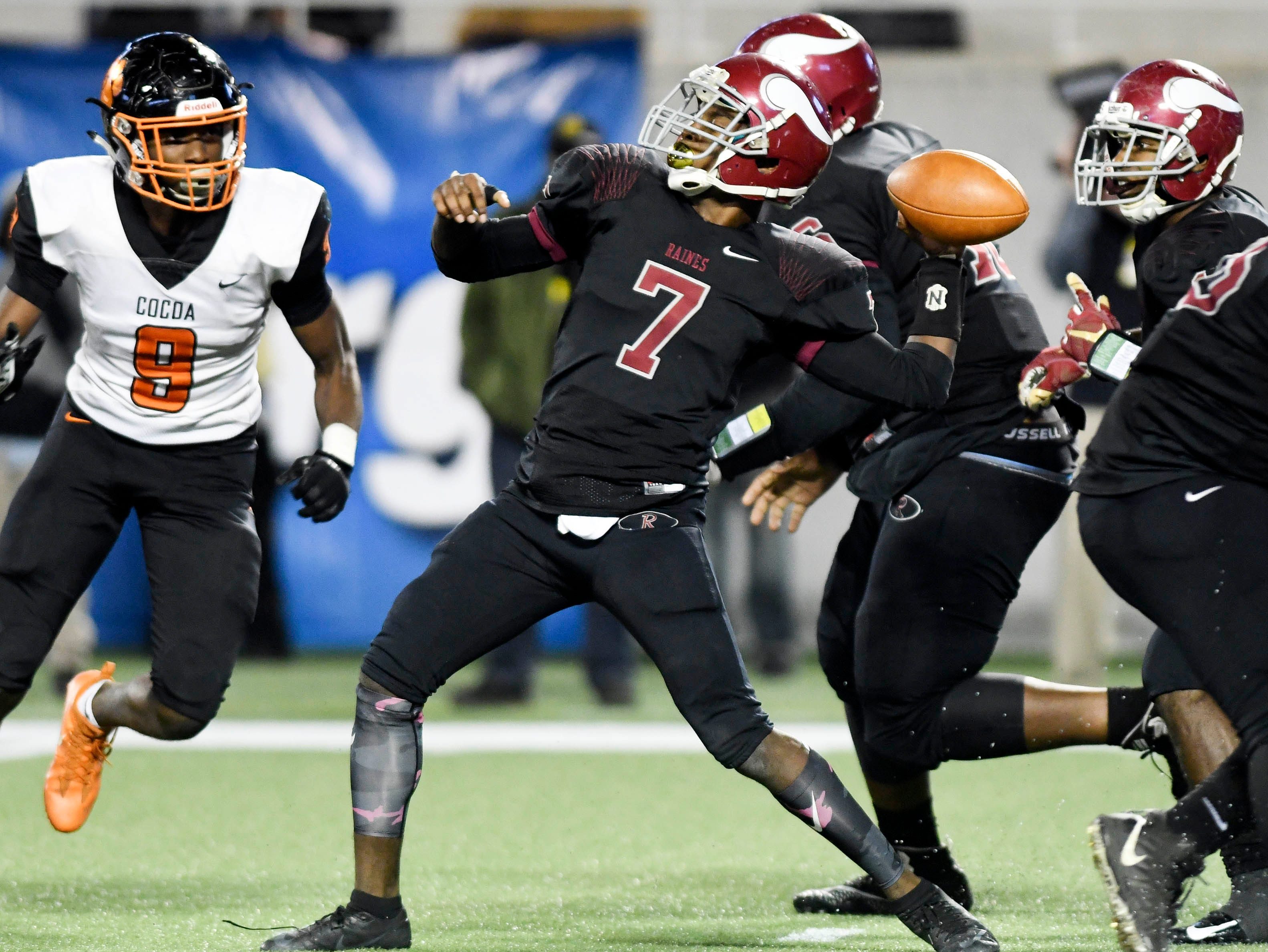 Jacorey Rivers of Raines passes under pressure during Thursday's Class 4A football state championship.