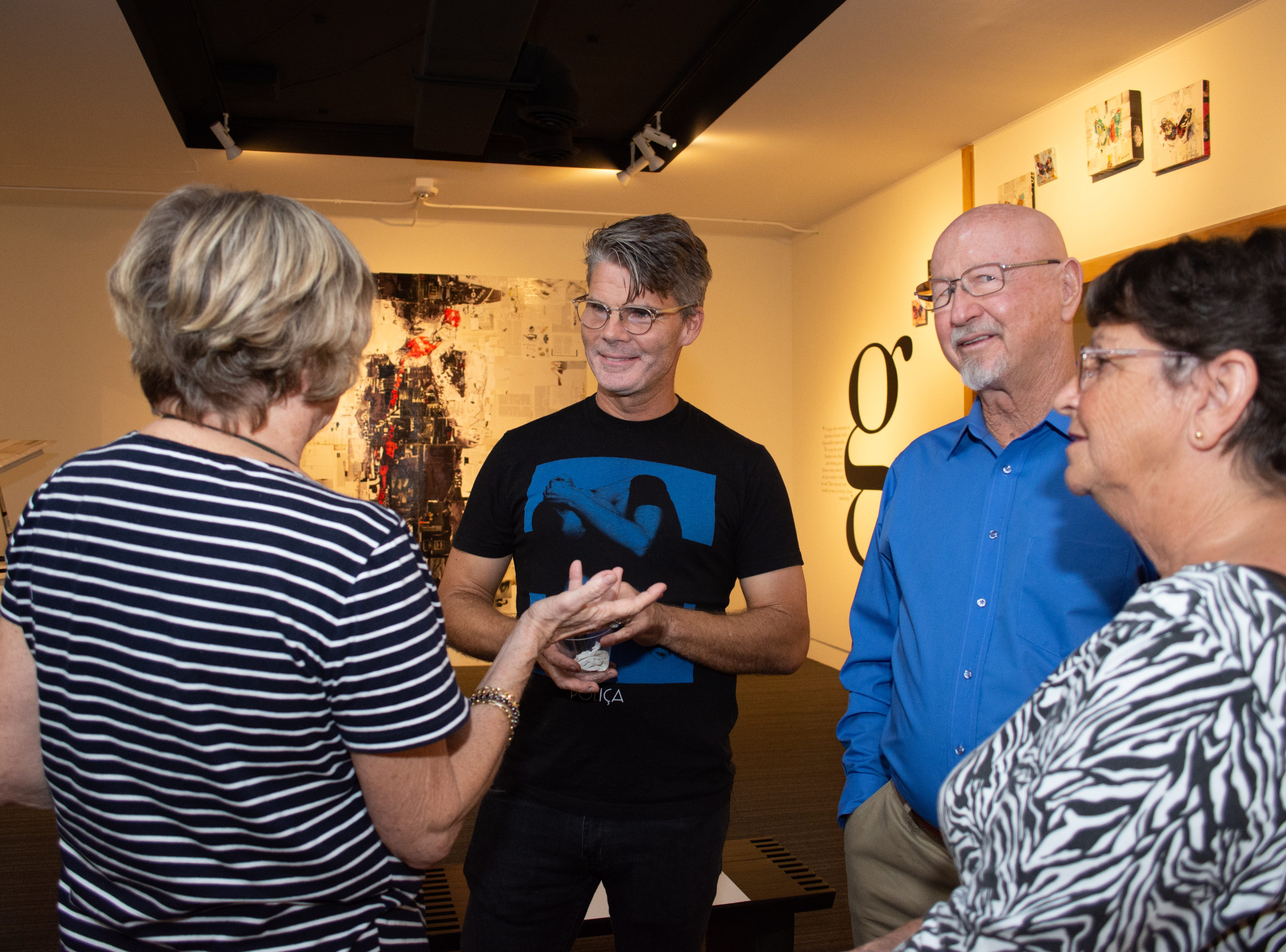 Photos from the Artworks Sponsor Party at Foosaner Art Museum which featured local artist Derek Gores' work.