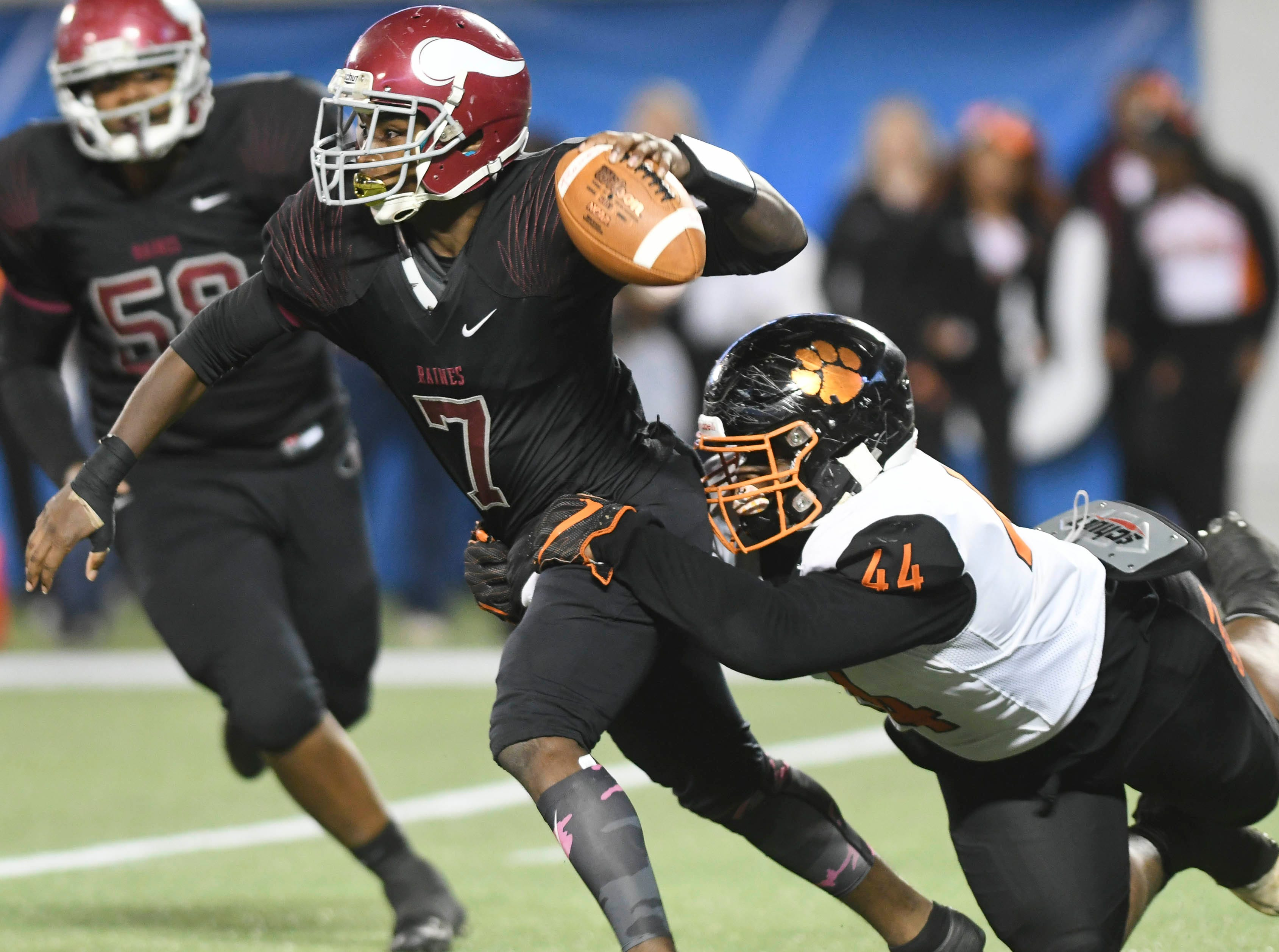 Dajavon White of Cocoa sacks Raines QB Jacorey Rivers during Thursday's Class 4A football state championship.