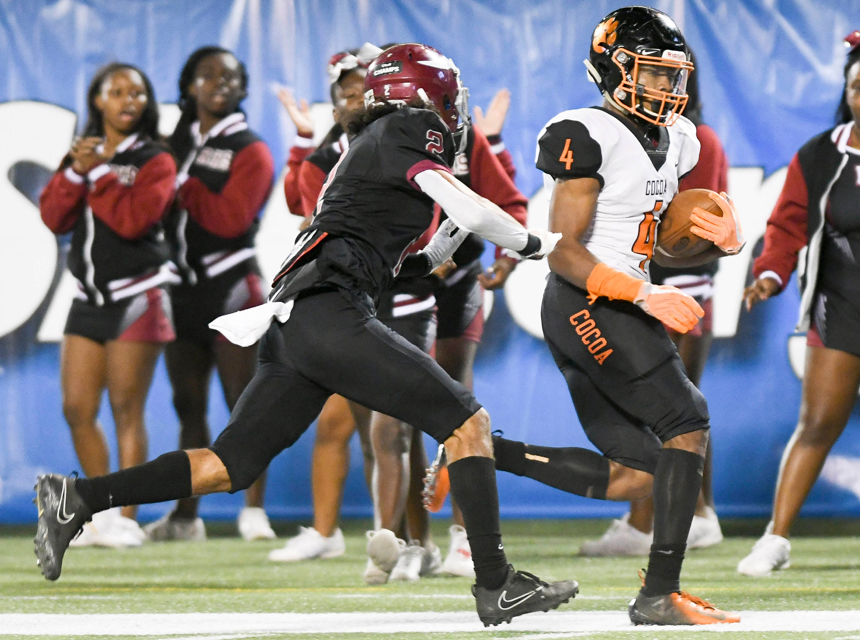 Willie Gaines of Cocoa is pushed out of bounds short of the goal line by Raines defender Treyvon Hobbs during Thursday's Class 4A football state championship.