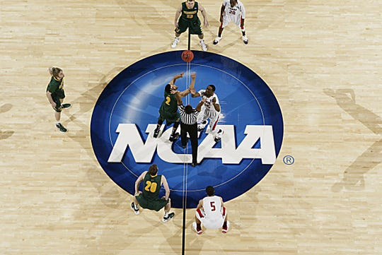 Vermont Catamounts players go up for the opening jump ball against the Lamar Cardinals during the first round of the 2012 NCAA men's basketball tournament at Dayton Arena. Vermont defeated Lamar 71-59.
