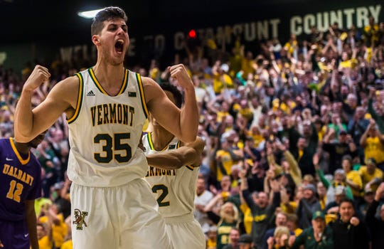Vermont Catamounts forward Payton Henson (35) celebrates during the America East Championship against the Albany Great Danes at Patrick Gym.