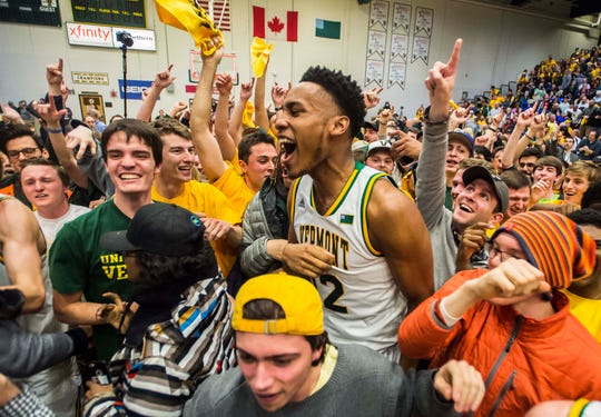 Vermont player Darren Payen celebrates after the America East Championship against the Albany Great Danes at Patrick Gym.