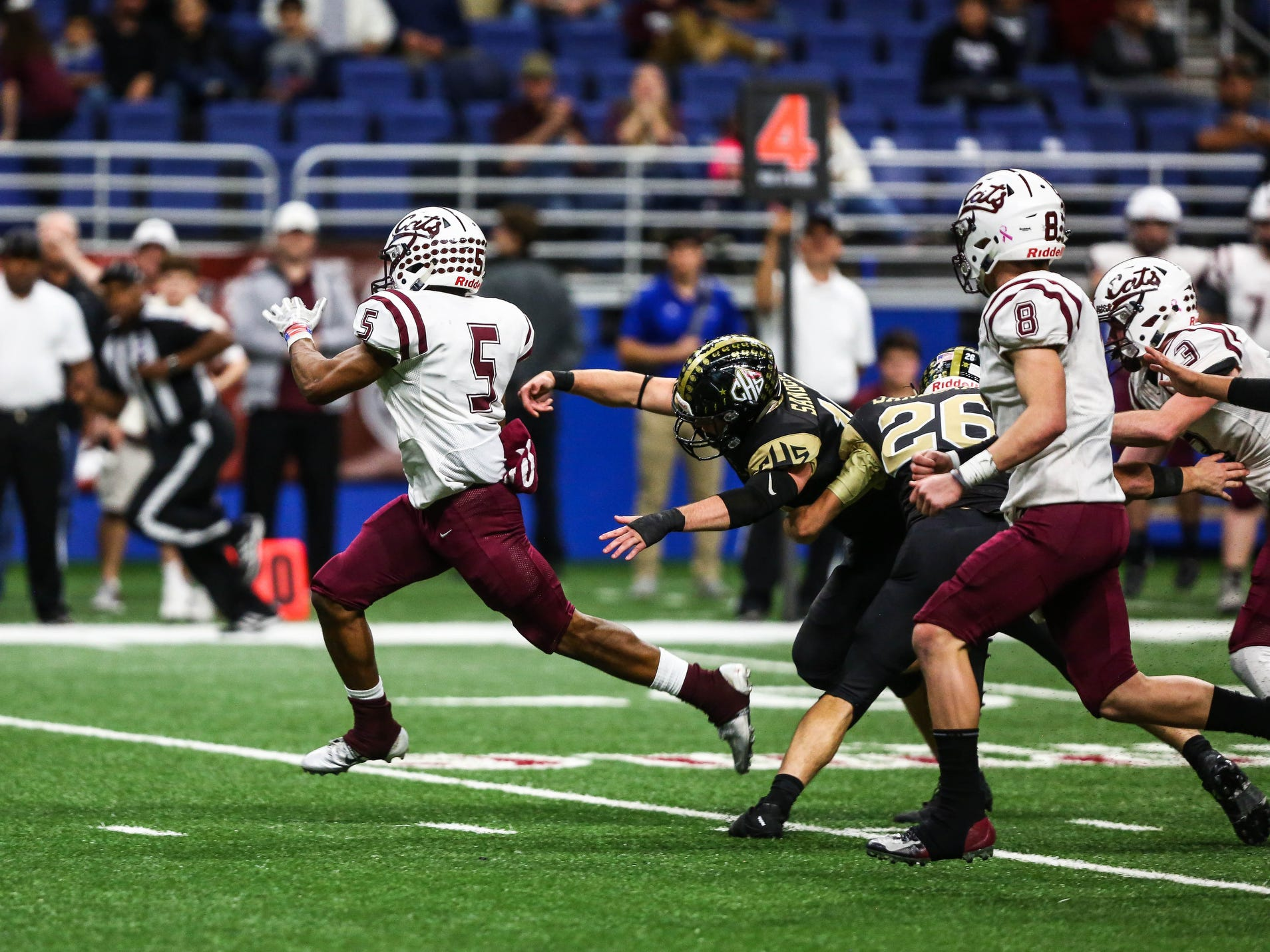 Calallen's Shenan Price runs the ball during Friday's game at the Alamodome.