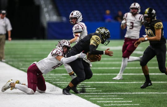 Calallen's Rivers Roy takes down Port Lavaca Calhoun's Daniel Martinez during the Class 5A Division II state quarterfinal Texas high school football playoff game Friday, Dec. 7, 2018 at the Alamodome.