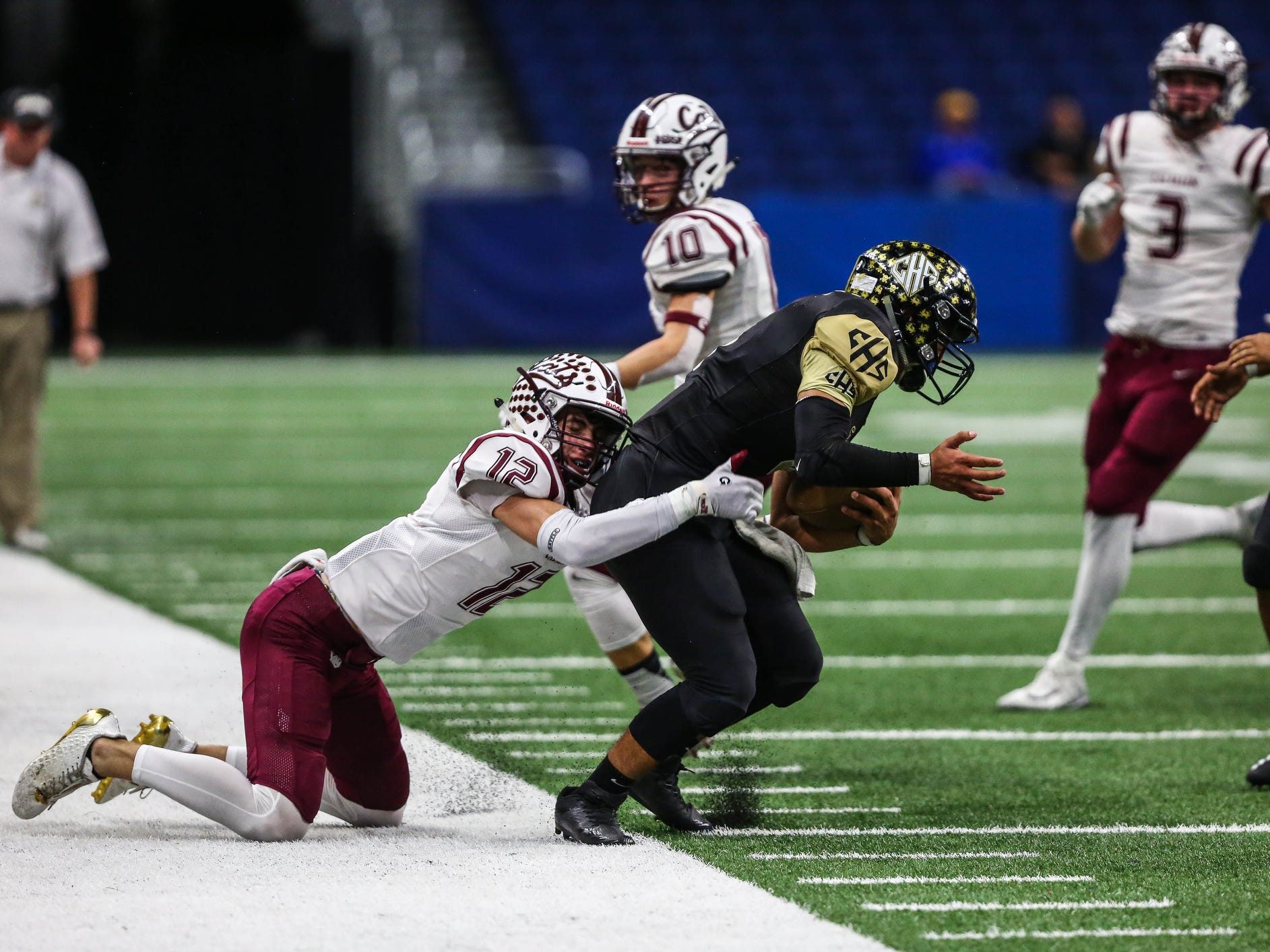 Calallen's Rivers Roy takes down Calhoun's Daniel Martinez during Friday's game at the Alamodome.