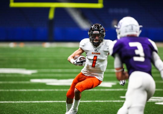 Refugio's Jordan Kelley runs the ball during Friday's Class 2A Division I state quarterfinal Texas high school football playoff game at the Alamodome.