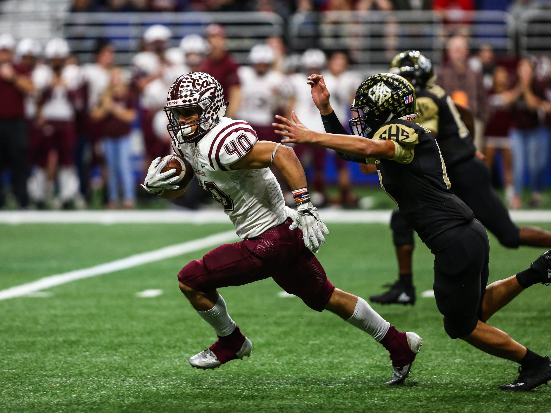 Calallen's Aj Brown runs the ball during Friday's game at the Alamodome.