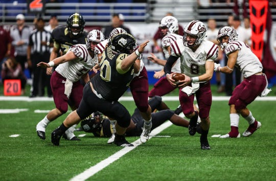 Calallen's Jarrett Garza carries the ball during Friday's Class 5A Division II state quarterfinal Texas high school football game Friday, Dec. 7, 2018 at the Alamodome.
