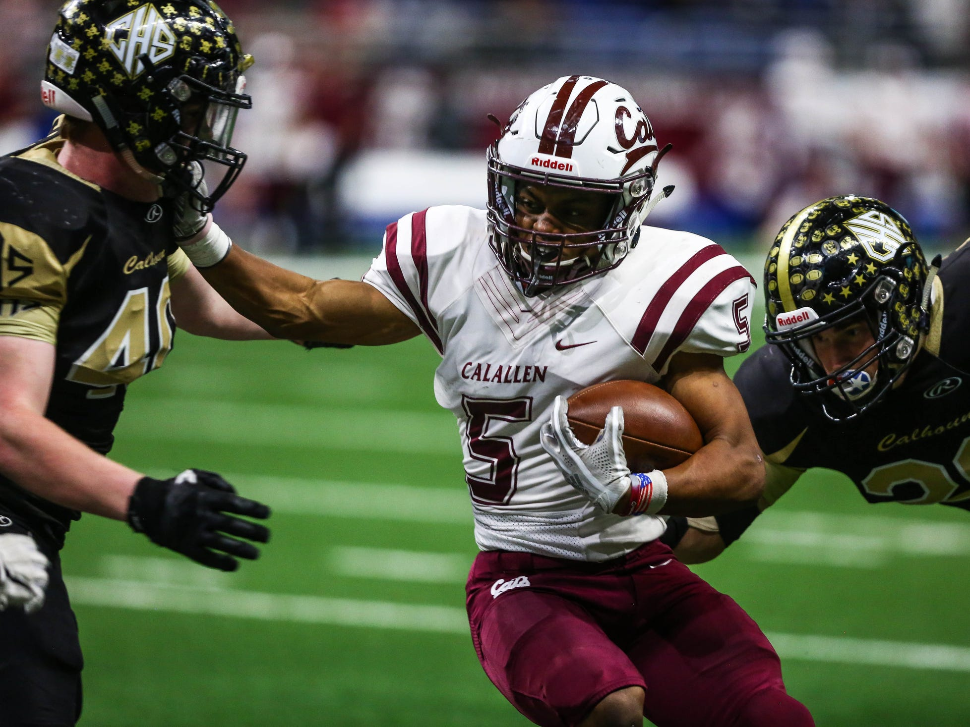 Calallen's Shenan Price tries to outrun Calhoun's defense during Friday's game at the Alamodome.