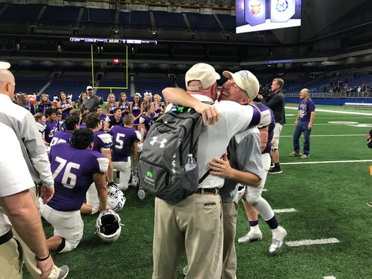 Mason head coach Kade Burns celebrates the Punchers' 28-14 Class 2A Division I state quarterfinal win over Refugio at the Alamodome on Dec. 7, 2018.