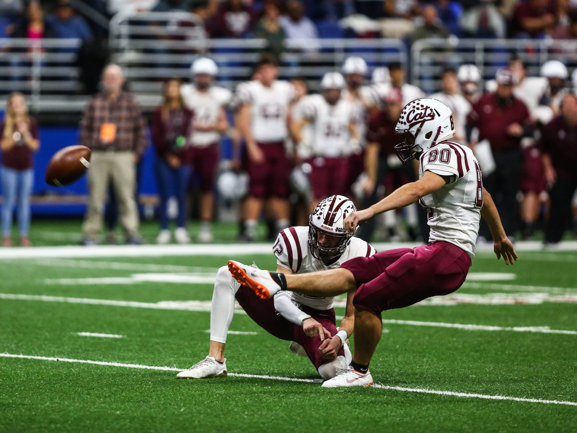 Calallen's Joao Trindade goes for a field goal during Friday's game at the Alamodome.