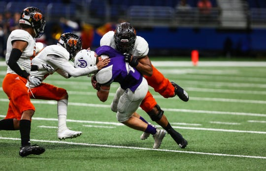 Refugio's defense takes down Mason's offense during Friday's Class 2A state quarterfinal game at the Alamodome.
