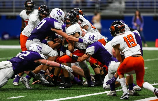 Mason's defense surrounds Refugio quarterback Austin Ochoa during the Class 2A state quarterfinals on Friday, Dec. 7, 2018, at the Alamodome.