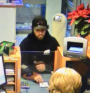 Police say this surveillance video image shows a PNC Bank branch being robbed Thursday in Washington Township.