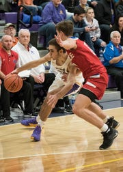 Unioto guard Cade McKee attempts to drive to the hoop past Zane Trace during the first quarter at Unioto High School.