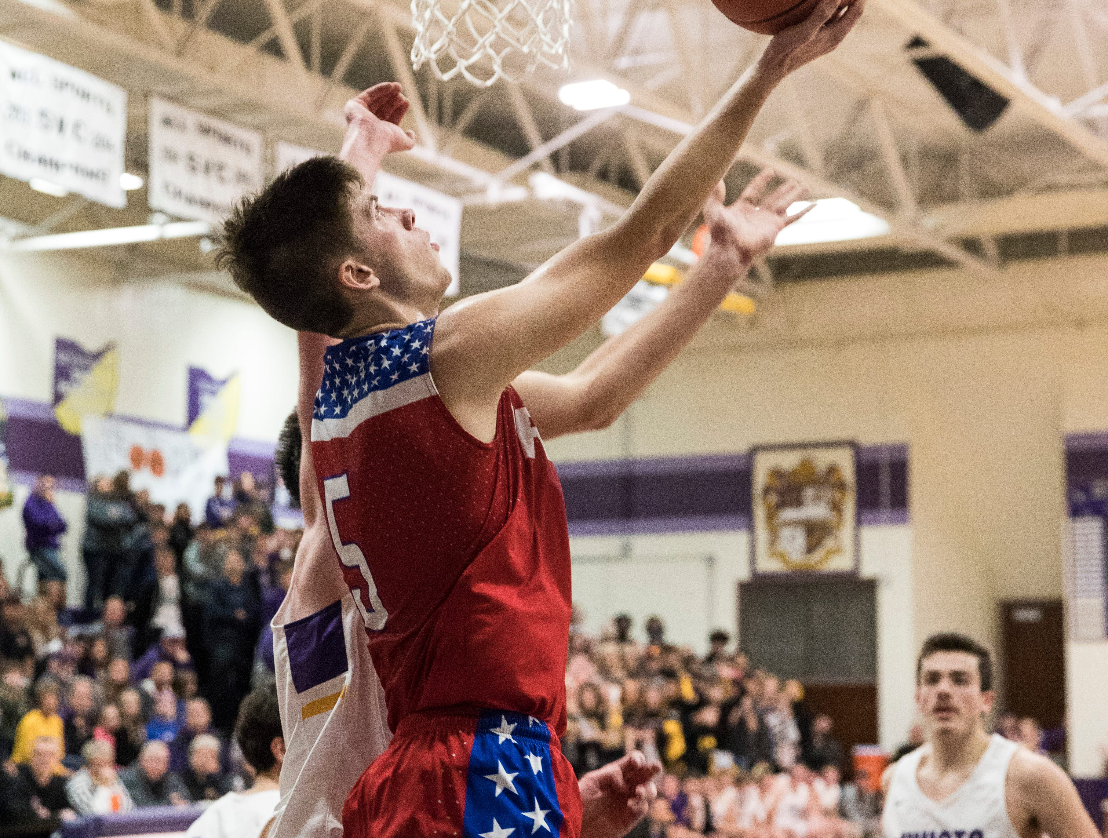 Zane Trace forward Nick Nesser goes for two over Unioto during the last quarter at Unioto High School. The Pioneers defeated the Sherman 69-50, breaking their historic SVC winning streak.
