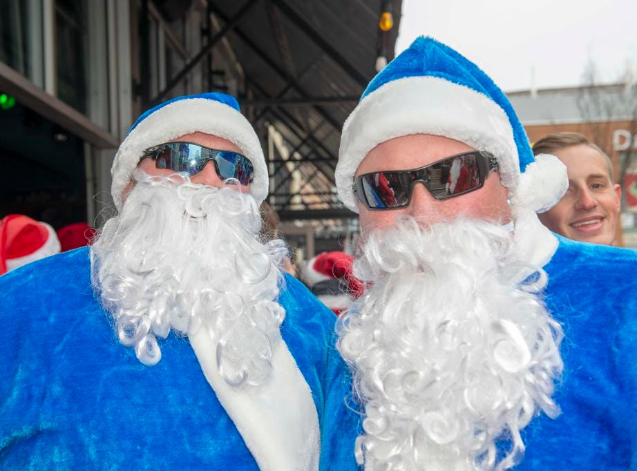 Cincinnati SantaCon 2018 brought hundreds of people dressed as Santa Claus and other Christmas characters to The Banks to spread good cheer and charity. Dale Wilkins and Chris Sumner.