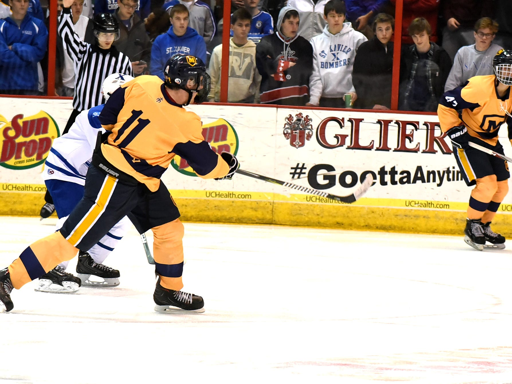 Shay Black (11) drives home the winning goal for Moeller in their 3-2 win over St. Xavier at US Bank Arena, December 7, 2018.