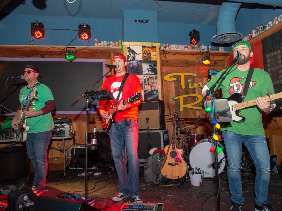 Cincinnati SantaCon 2018 brought hundreds of people dressed as Santa Claus and other Christmas characters to The Banks to spread good cheer and charity. The Tyer Moore Band played at the Tin Roof bar