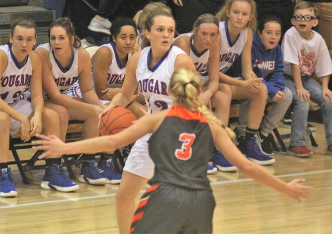 Conner senior Courtney Hurst looks for an opening against Ryle sophomore Brie Crittendon as Ryle defeated Conner 60-49 in a girls basketball district game Dec. 7, 2018 at Conner High School, Hebron KY.