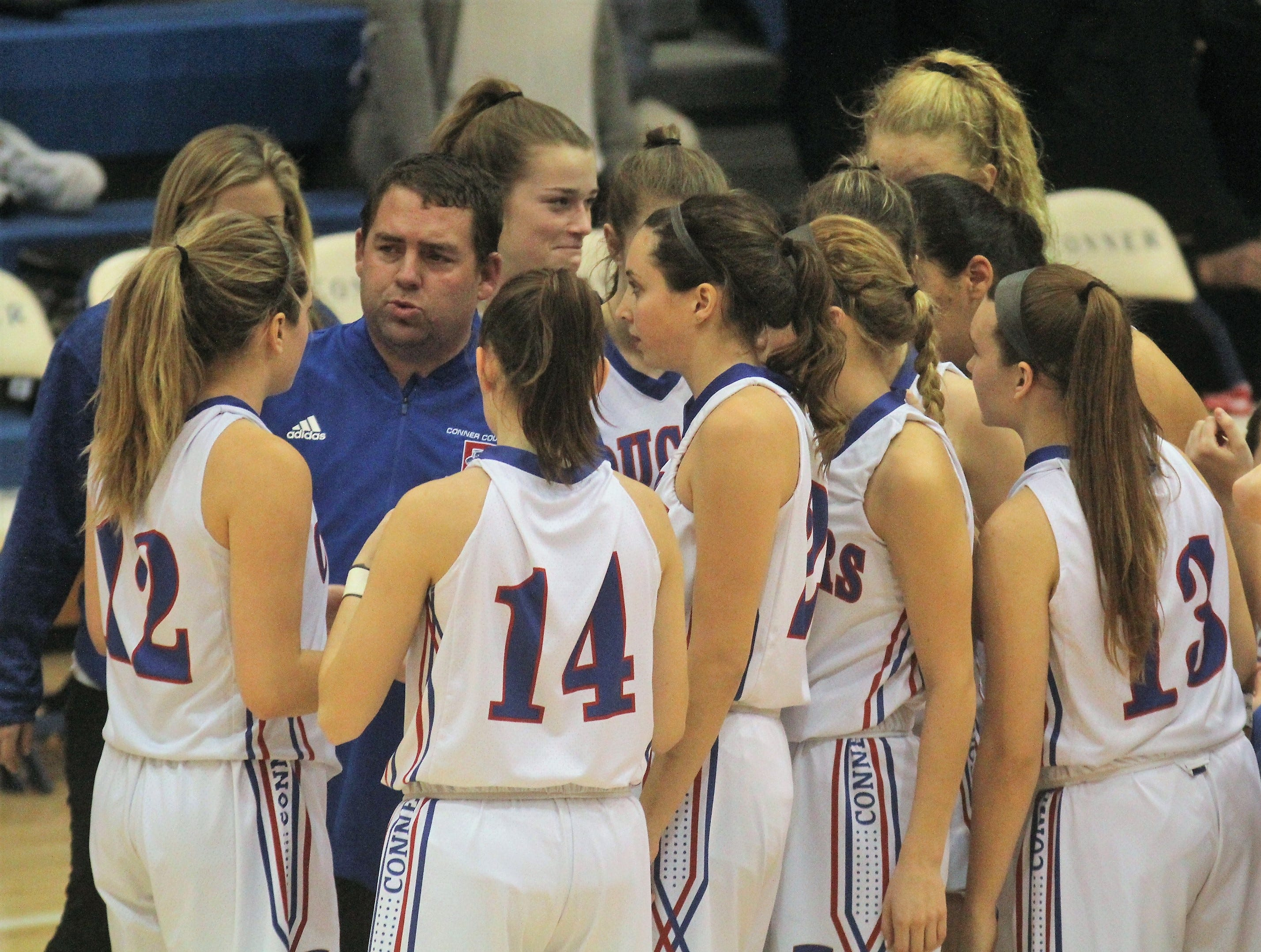 Conner head coach Aaron Stamm talks to the Cougars during a time out, as Ryle defeated Conner 60-49 in a girls basketball district game Dec. 7, 2018 at Conner High School, Hebron KY.